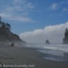 Three hikers brave the mist on Ruby Beach, Olympic National Park, Washington