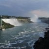 Niagara Falls - the American Falls, Horseshoe Falls, Hornblower Boats, Maid of the Mist Boats, and Observation Tower as seen from the Rainbow Bridge, Niagara Falls, Canada and Niagara Falls State Park, New York.