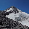 Mt. Hood stands grandly over the Elliot Glacier as seen from the Cooper Spur Trail, Mount Hood National Forest, Oregon