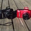 A black model and red model of the Canon PowerShot SX160 camera