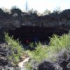 Walking into the entrance of Indian Well Cave in Lava Beds National Monument, California