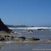views of the Yaquina Head Light just before rounding Schooner Point south of Beverly Beach and Moolack Beach, Oregon