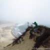 Jumping atop the sand dune at Cape Kiwanda, Oregon