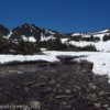 A stream frees itself of the snow in the cirque below Burro Pass above the Virginia Lakes in Humboldt-Toiyabe National Forest, California