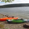 A Lifetime Lancer 100 Kayak and L.L. Bean Manatee 100 Kayak on the shore of the lake