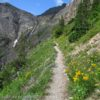 Hiking the Swiftcurrent Pass Trail up through the Swiftcurrent Amphitheater, Glacier National Park, Montana