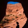 Silhouette of a hiker in The Tunnel, Arches National Park, Utah
